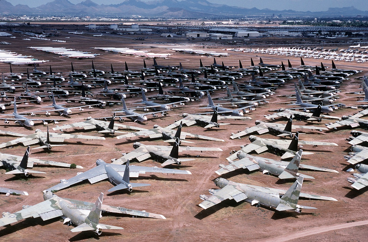 Many dilapidated planes in a desert.